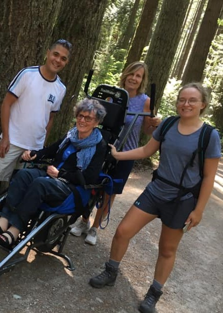 Maria and volunteers on a hike with a TrailRider.